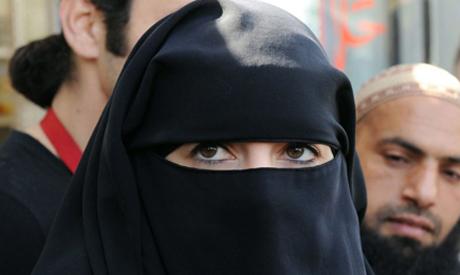 A Muslim woman wearing a full-face veil, France