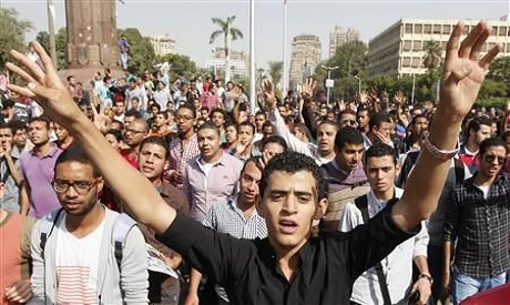 Cairo university students and members of the Muslim Brotherhood shout slogans against the military i