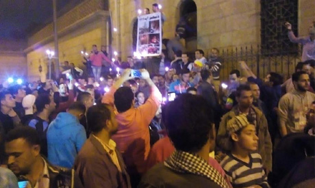 Mourners holding candles and praying around St Peter and St Paul (El-Botroseya) Church, Sunday, the