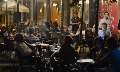Egyptians relax outside a cafe in Cairo