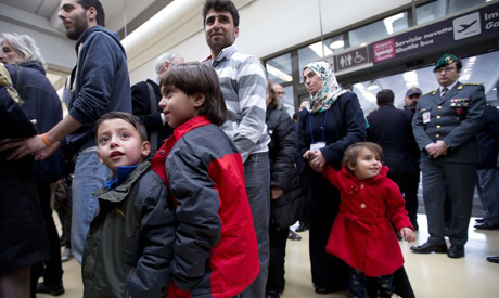 Syrian children blow kisses as they arrive in Italy's first airlift