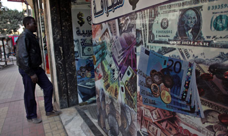 A Man Walks Next To Currency Exchange Office In Downtown Cairo Egypt Photo Ap