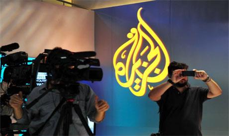 Al Jazeera journalist Peter Greste stands inside the defendants
