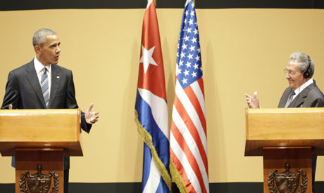 U.S. President Barack Obama, left, speaks next to Cuba