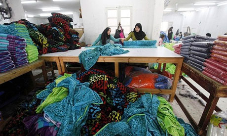 Egyptian women work at a textile mill in Mahalla El-Kubra