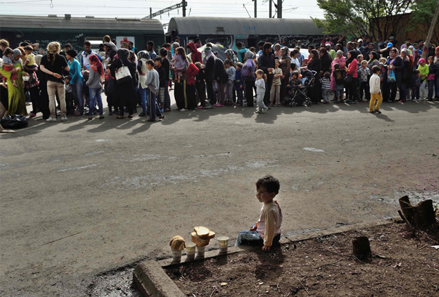 Picture of the day: Migrants wait in line for trains at the Greek-Macedonian border