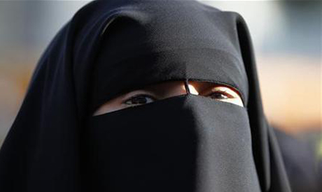 A woman wears Islamic Face veil