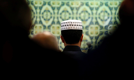 Members of the Muslim community pray in a mosque in Marseille