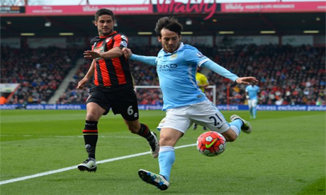 vies with bournemouth s south african born english midfielder andrew surman l during the english premier league football match between bournemouth and