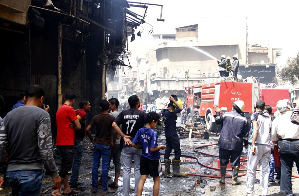 Firefighters putting off fires in Al-Rewaiei