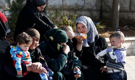 Syria women and children wait to get a visa stamp
