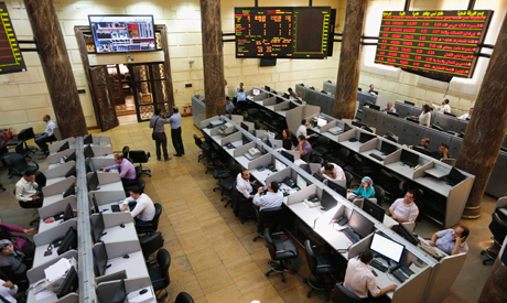 Traders work at the Egyptian stock exchange in Cairo August 18, 2013 (Reuters)