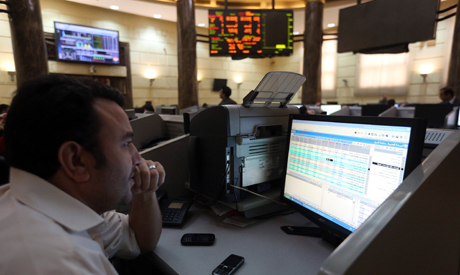 A trader works at the Egyptian stock exchange in Cairo November 19, 2014 (Reuters)