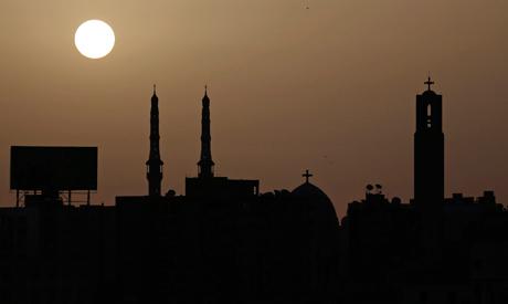 Sun rises behind a mosque