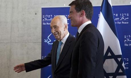 Former Israeli president Peres and French Prime Minister Valls