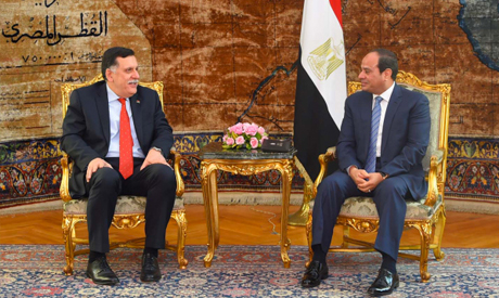 gyptian President Abdel Fattah al-Sisi (R) meeting with Libyan Prime Minister of the UN-backed unity