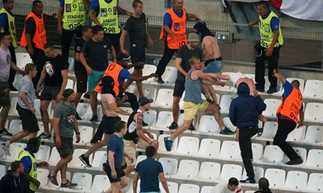 fans clash in the stadium after the match. (Reuters)