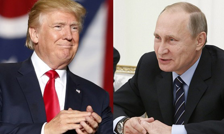 Donald J Trump and Vladimir Putin are both smiling in this ahram photograph