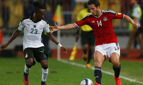 Ramadan Sobhi and Ghana's Harrison Afful in action in a World Cup qualifier in November which Egypt
