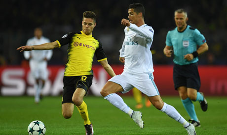 35d81ecfb Dortmund s German midfielder Julian Weigl and Real Madrid s forward from  Portugal Cristiano Ronaldo vie for the ball during the UEFA Champions League  Group ...
