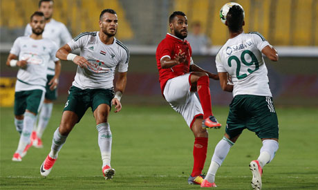 Al Ahly Hossam Ashour in action with Al Masry Hamada Nasser (Reuters)