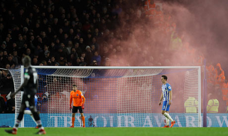 A General view of of red smoke during the game (Reuters)