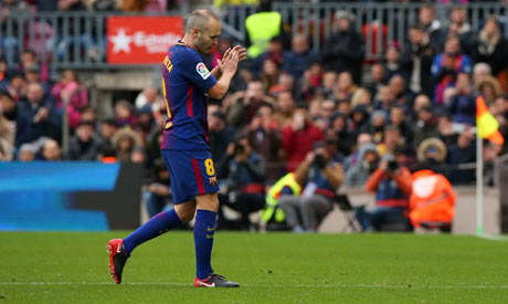 Andres Iniesta applauds the fans after he is substituted   (Reuters)