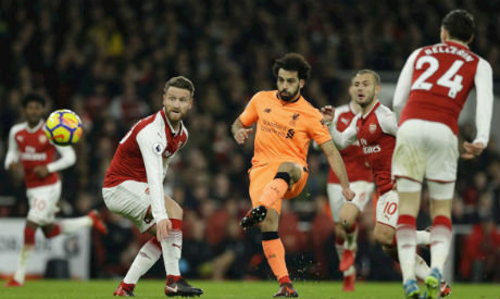 Liverpool hold Arsenal in six goals thriller