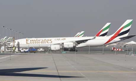 Emirates Airlines planes are parked at the Dubai International Airport (Reuters)