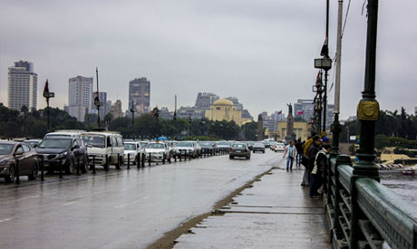 File photo: Cars drive on Qasr El-Nile bridge after a heavy rainfall in Cairo, Egypt (Al-Ahram)