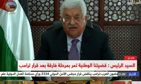 An image grab taken from Palestine TV shows Palestinian president Mahmoud Abbas giving a televised s