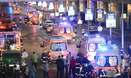 Paramedics help casualties outside Turkey