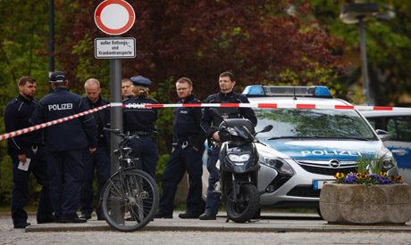 Berlin police shoot man who threated officer