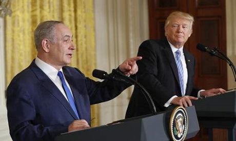 President Donald Trump listens as Israeli Prime Minister Benjamin Netanyahu speaks during their join