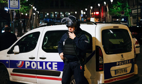 A French Police officer stands guard in front of the North station in Paris (AFP)