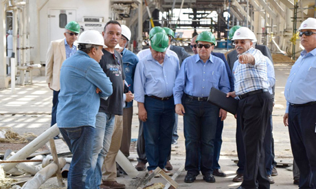 The minister of oil at the factory