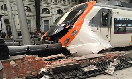 At least 40 injured after commuter train crashes into Barcelona station
