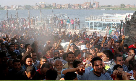 Egyptians shout slogans against the government during the funeral of Syed Tafshan, who died in clash