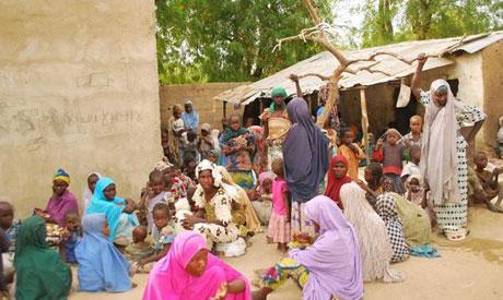 women gathered outside a tent in a remote community of Maiduguri, northeast Nigeria