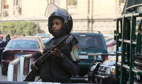 police officer stands guard outside the high court in Cairo (Reuters)