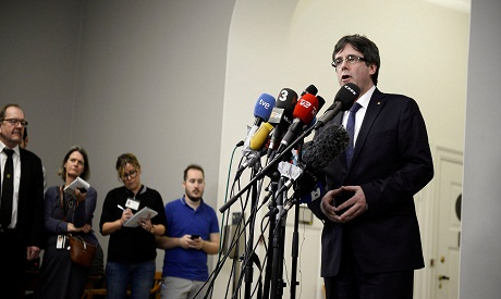 Catalonia ousted chief Puigdemont asks for 'risk-free' return to Spain