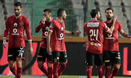 Egypt's Ahly player Abdallah el-Saeed (R) celebrates with his teammates after scoring a goal (AFP)