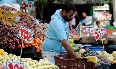 File Photo: A trader waits for customers at a market in Abbdien square in Cairo, Egypt (P