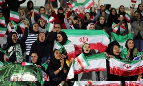 Iranian women cheer during the friendly football match between Iran and Bolivia at the Azadi Stadium