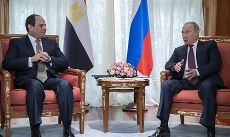 Russian President Vladimir Putin, right, and Egyptian President Abdel-Fattah el-Sisi talk during the