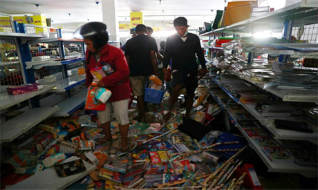 Earthquake and tsunami victims look for goods