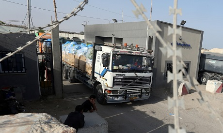 A truck carrying fruits arrives at Kerem Shalom crossing after it was reopened by Israel, in Rafah i