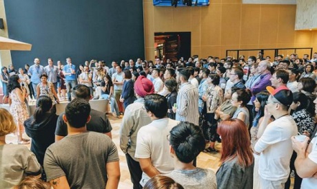 Google employees gather in a common area to attend the Google Walkout in Singapore, November 1, 2018