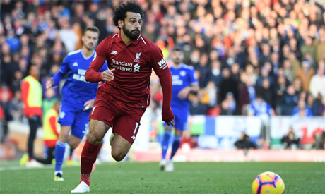 c737de31c27f55 File Photo  Liverpool s Egyptian midfielder Mohamed Salah runs with the  ball during the English Premier League (Photo  AFP)