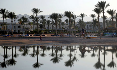 Tourists are seen on a beach in the Aqaba Gulf on the Red Sea resort of Sharm el-Sheikh (Reuters)
